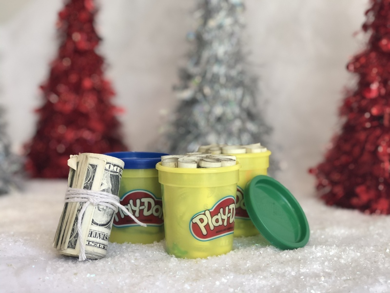 picture of money hidden inside playdough containers - a Christmas gift idea