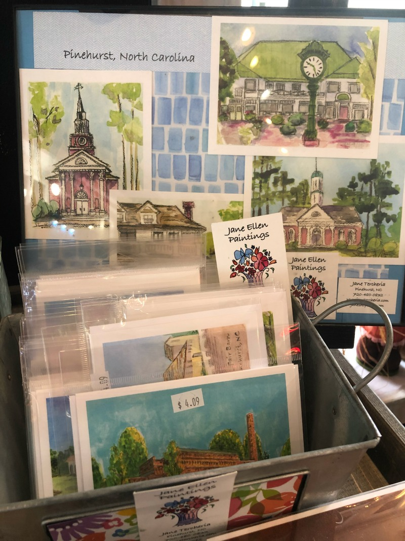 These hand-painted images of local landmarks and images make great gifts!