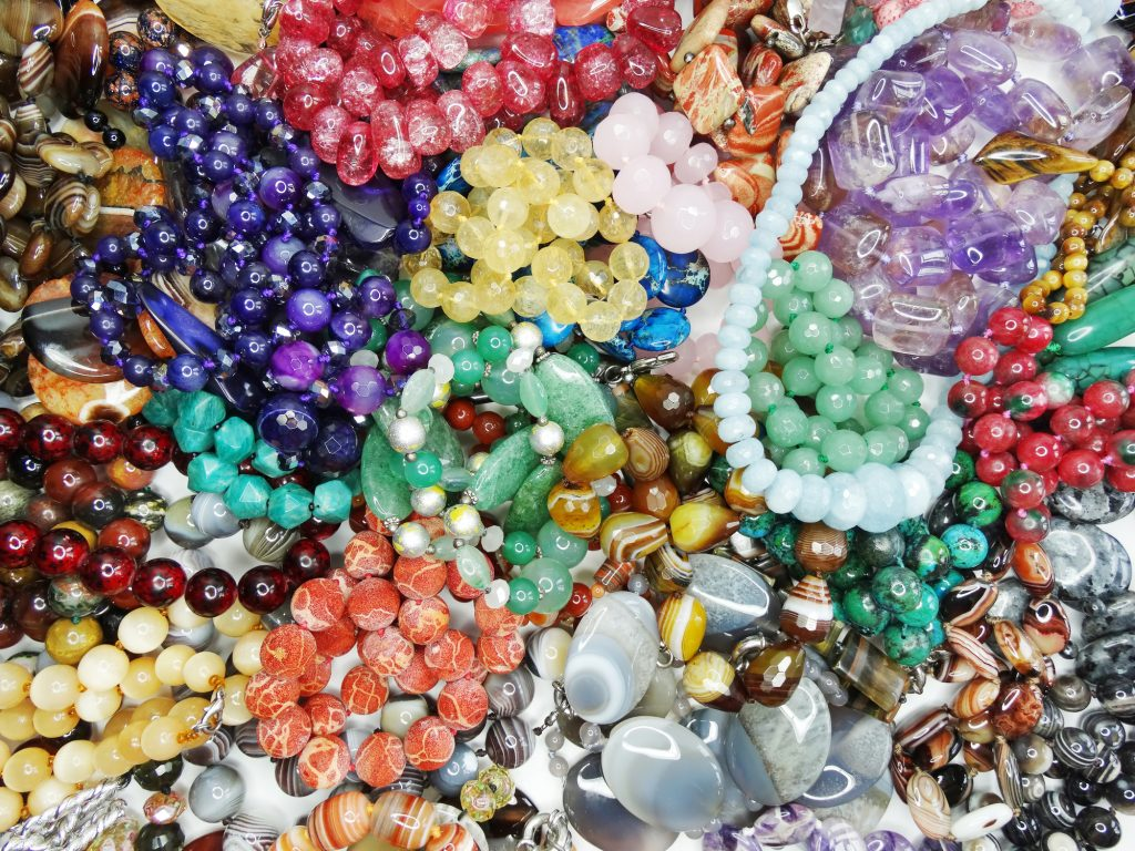 Piles of beads to create jewelry for young entrepreneurs