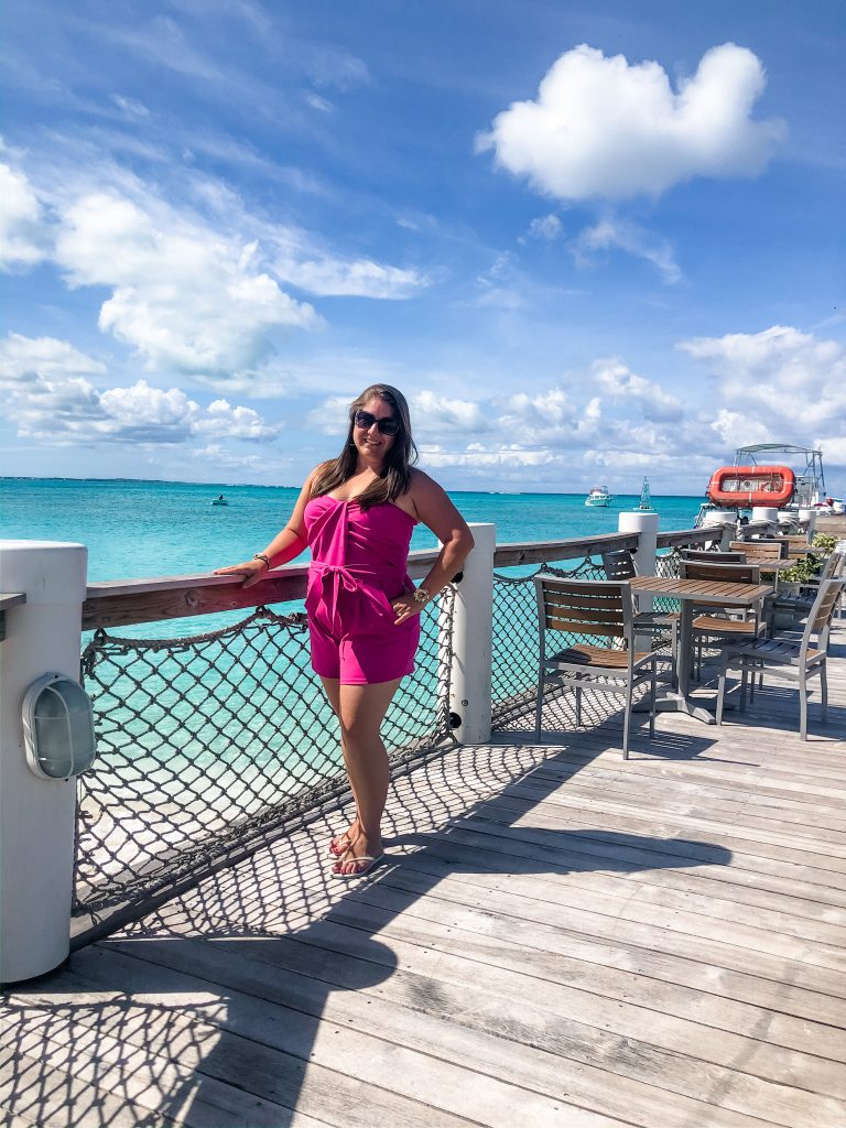 picture of woman wearing pink designer jumpsuit at beaches turks & caicos