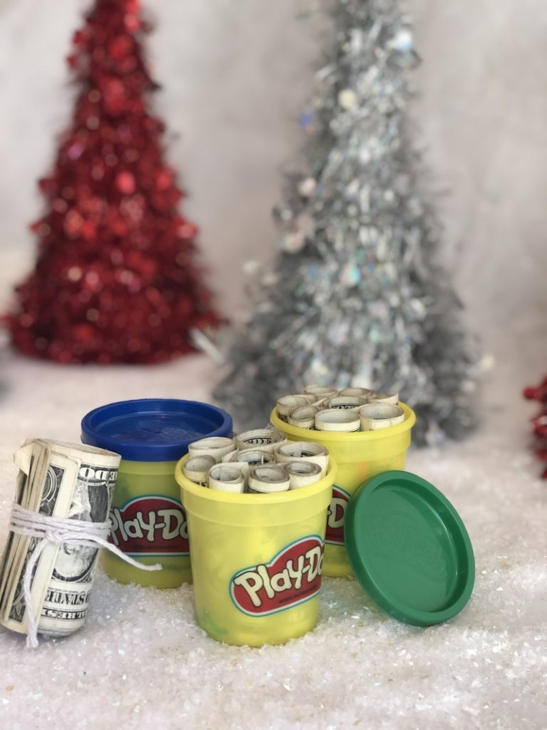 playdough containers filled with money for a kid