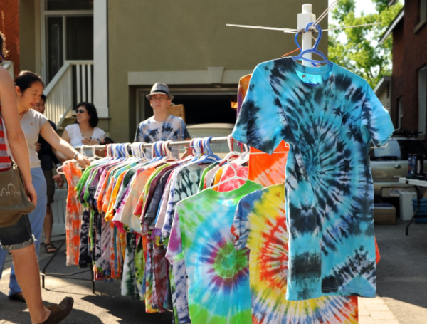 tie dye t-shirts being sold at a street fair