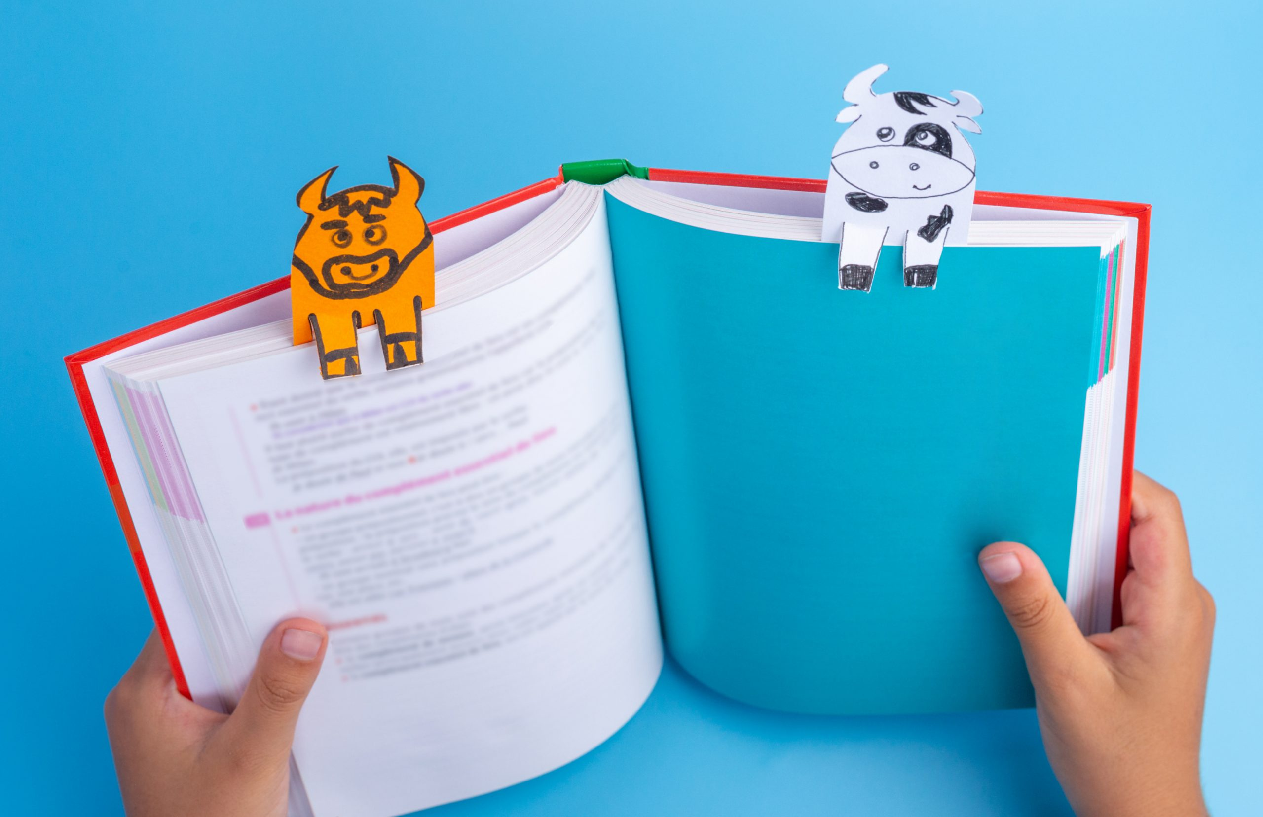 handmade bookmarks of cows on a book