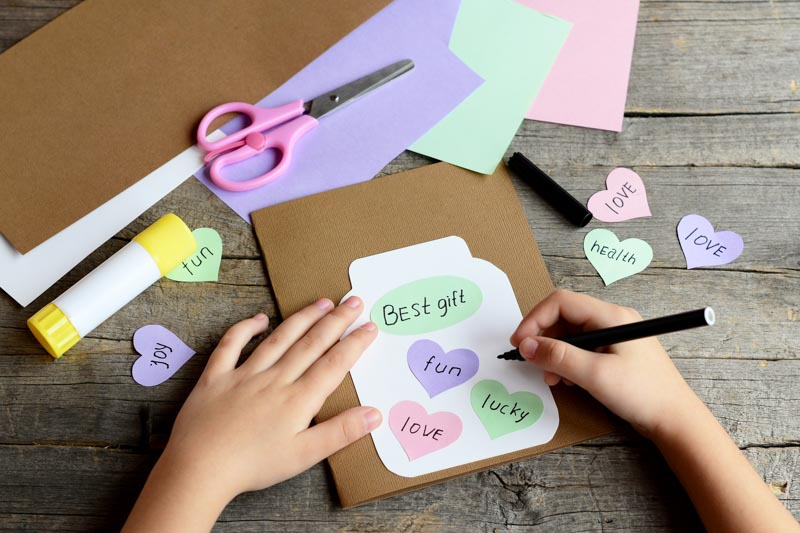 child making a homemade card