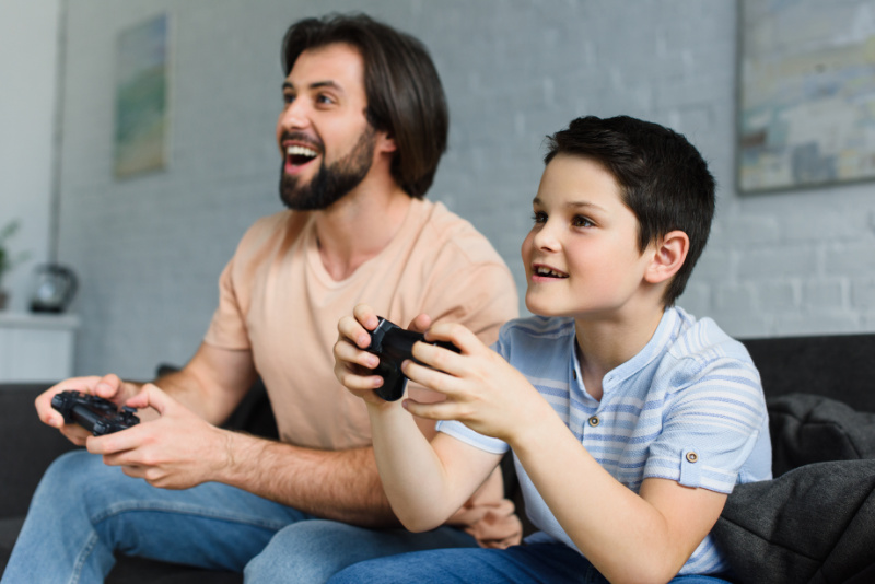 dad and son play video games